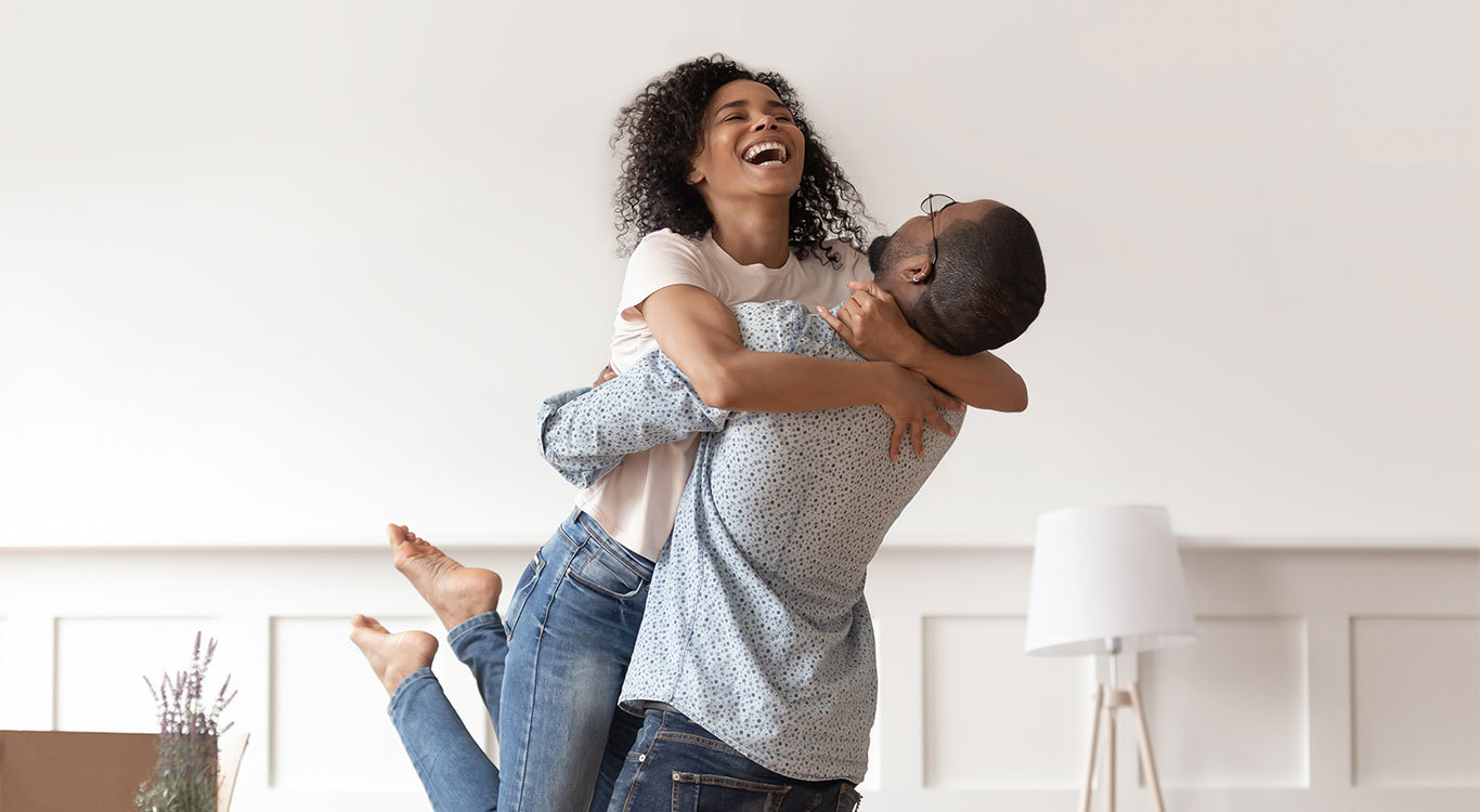 happy-couple-celebrating-good-news